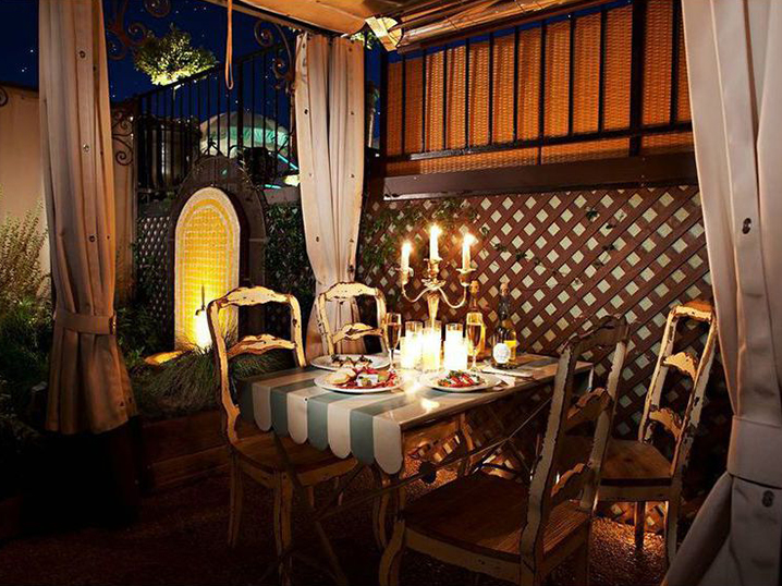 los angeles most romantic hotel - petit ermitage candlelit table